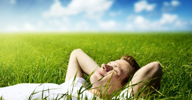 man_relaxing_field_sun_calm_peaceful_1